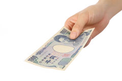 Pay a Japanese 1000YEN bill Royalty Free Stock Image