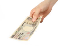 Pay a Japanese 10000YEN bill Royalty Free Stock Images