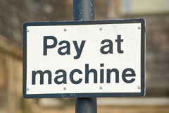 Pay at machine sign. Royalty Free Stock Image