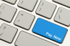 Pay Now Key. Close Up of Blue Pay Now Key Button on Keyboard Royalty Free Stock Images