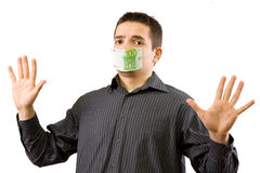 Pay off. The businessman which mouth is gagged with money (isolated in white background Royalty Free Stock Photo