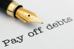 Pay off debts. Close up of Pay off debts Royalty Free Stock Photography