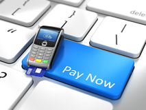 Pay online concept - Payment terminal on computer keyboard Stock Images