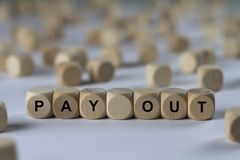 Pay out - cube with letters, sign with wooden cubes Stock Photo