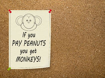 Pay peanuts, get monkeys - office saying. Notice. Stock Photography