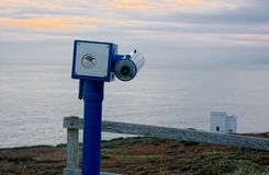 Telescope overlooking seaview at sunset royalty free stock photo