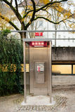 Pay phone booth in Germany Royalty Free Stock Photos