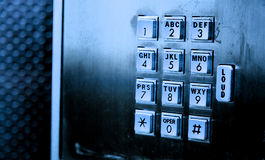 Pay phone keypad. Payphone keypad in blue light Royalty Free Stock Photography