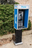 Pay Phone on a Sidewalk Royalty Free Stock Photo