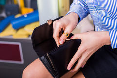 Pay for purchase. Beautiful female hands open purse. Closeup Royalty Free Stock Image