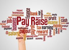 Pay Raise word cloud and hand with marker concept. On gradient background stock photo