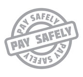 Pay Safely rubber stamp Stock Photo