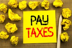 Pay Taxes. Business concept for Taxation Overtax Return written on sticky note paper on the vintage background. Folded yellow pape. Pay Taxes. Business concept Stock Images