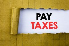 Pay Taxes. Business concept for Taxation Overtax Return written on white paper on the yellow folded paper. Pay Taxes. Business concept for Taxation Overtax Royalty Free Stock Images