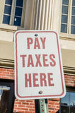 Pay Taxes Here Sign Stock Image