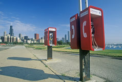 Pay Telephones and Chicago Skyline, Chicago, Illinois Stock Photo