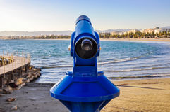 Pay telescope overlooking maritime city. Costa Dorada, Spain. Royalty Free Stock Images