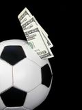 Money in a soccer ball Royalty Free Stock Photos