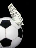money in a soccer ball Royalty Free Stock Photos