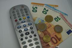 Pay TV. How much we have to pay to see our favorite Programm on TV Stock Photography