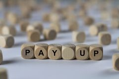Pay up - cube with letters, sign with wooden cubes Royalty Free Stock Photography