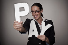 Pay for woman. A income concept image of a woman holding letters that spell out the word pay demonstrating fare pay for woman Royalty Free Stock Photo
