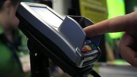 Pay for your purchases with a card through the terminal. HD, 1920x1080, slow motion stock video footage