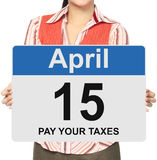 Pay Your Taxes. A woman holding a sign indicating April 15 Stock Images