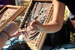 Payable jewels. Market with modern payable jewels Stock Photo