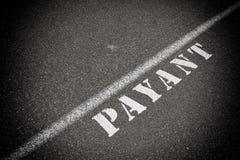 Payant on asphalt road Stock Image