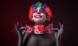 Payaso asustadizo con maquillaje fantasmagórico y más caramelo Imagen de archivo libre de regalías