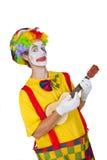 Payaso colorido con el ukulele Fotos de archivo