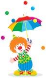 Payaso de circo con un paraguas Foto de archivo libre de regalías