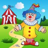 Payaso de la historieta con la tienda de circo Fotos de archivo libres de regalías
