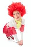 Payaso de la mujer con el pelo rojo Imagen de archivo