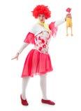 Payaso de la mujer con el pelo rojo Fotografía de archivo libre de regalías