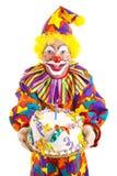 Payaso del cumpleaños con la torta Foto de archivo libre de regalías