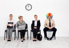 Payaso entre candidatos de trabajo Imagen de archivo libre de regalías