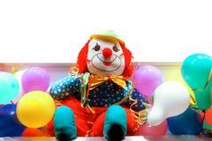Payaso entre los globos coloreados Foto de archivo libre de regalías