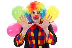 Payaso feliz con los globos, gesticulando con la mano Imágenes de archivo libres de regalías