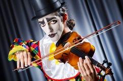 Payaso que juega en el violín Fotografía de archivo