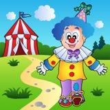 Payaso sonriente con la tienda de circo Foto de archivo