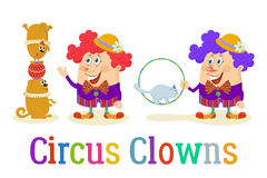 Payasos de circo con los animales entrenados Foto de archivo