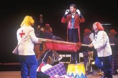 Payasos y director de pista de circo, hermanos de Ringling y Barnum y Bailey Circus Fotografía de archivo