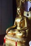Payathonsu, Myanmar - December 30, 2018: Vintage Golden Gilded Buddha image statue at Tai Ta Ya Monastery, Buddhist Temple. Day. Trip Thailand Myanmar Tourist stock image