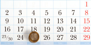 Payday on the list of calendar. With coins Stock Image