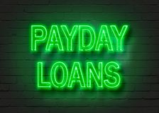 Payday loans, neon sign on brick wall. Background. 3D illustration Royalty Free Stock Image