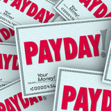 Payday Word Checks Money Income Earned Working Job. Payday word on checks in a pile of earnings, compensation, wages or income earned from working your job Royalty Free Stock Image