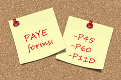 PAYE forms information sticky notes pinned to cork board Stock Photos