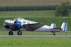 Beech D18S vintage twin engine executive aircraft N223CM royalty free stock images
